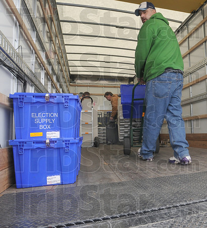 Special delivery: Rodney Christenberry carts voting machines from a delivery van at West Vigo High School Monday afternoon. In the background Leo Burskey and John Brown prepare others materials the poll workers will need for todays' election.