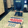 Prep work: Scott Daugherty wheels election day signs into t he courthouse Monday afternoon. He and other workers from Pat Mansards' Vigo County Clerks office spent the day getting ready for todays' election.