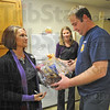 Thanks: Natalie Overton and Jenny Strole of Servpro deliver a Thanksgiving to Terre Haute Fire Department Lt. Eddie Hamblen Monday afternoon. The local company gave the baskets to each city firestation as well as the full time Honey Creek fire department.