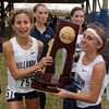 Winners: Villanova Women won the national Championship cross country race Monday. Here they carry their trophy. Team members include: Amanda Marino(751), Sheila Reid, back right, who also was the race winner and Emily Lipari, right.