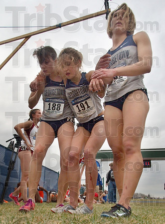 Teammates: Georgetown runners Kirsten Kasper(188) and Renee Tomlin(192) help their teammate Joanna Stevens(192),