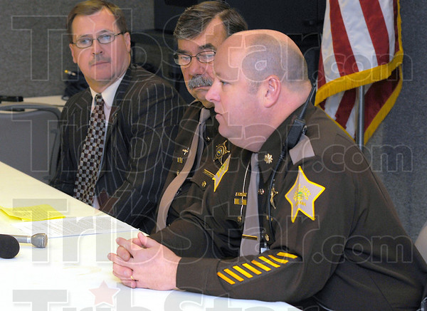 "In custody: Vigo County Prosecutor Terry Modesitt and Sheriff Jon Marvel listen while Sheriff-elect Greg Ewing talks about an arest in the hit-and-run death of Nate Lawson. ""How little closure there is when losing a child, I can't imagine."" Ewing said."