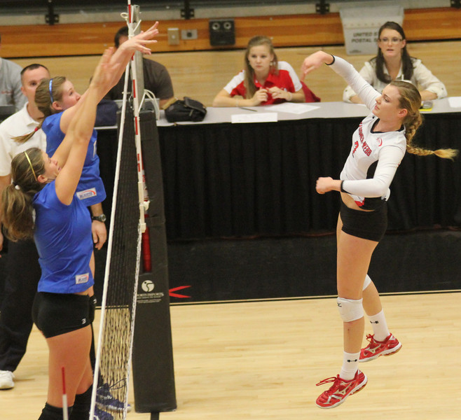 Outside hitter Melissa Richie (7) gets a hit over two UNC-Asheville Bulldogs on November 9th, 2010.
