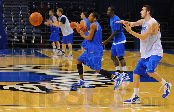 Drill baby drill: ISU mens basketball players go though passing drills at the start of practice Tuesday.