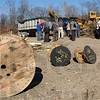 Raw material: Along with trees and bushes, wooden spools lay ready to be ground into biomass for the St. mary-of-the-Woods generator. Attendees of the biomass conference look over the storage facility just off US 150 on Sisters of Providence property.