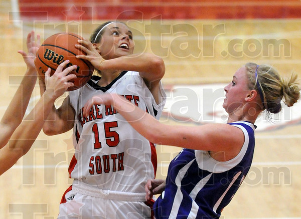 Whacked: Terre Haute South's #15, Haley Seibert gets grabbed by two Bloomington South defenders during first half action Tuesday night.