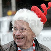 Grinch?: Rod Henry sports a Christmas Grinch hat as he assists Duke Energy and Win Energy crews installing holiday decorations along Wabash Avenue Tuesday afternoon.