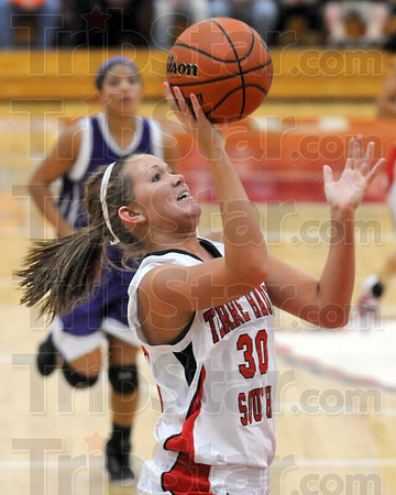 Runner: South's #30, Emily Bell takes a runner down the lane during first half action Tuesday night against Bloomington South.