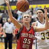 Mine: Terre Haute South's #35, Hannah Lee blocks out Sullivan's #33, Rhagen Smith to get a first half rebound Tuesday evening.