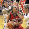 On the chin: South's Haley Seibert takes on to the chin from a Sullivan defender during first half action Tuesday night.