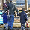 Thankful: A young family crosses Wabash Avenue as they leave the Lighthouse Mission Tuesday Tuesday afternoon after receiving a food basket.