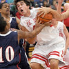 Mine: South's #44, Lucas Steward rips down a rebound during action against Terre Haute North during Friday's Jamboree.