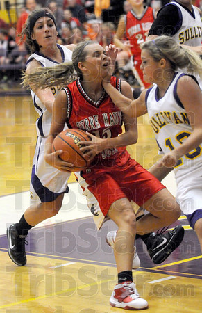 On the chin: South's #15, Haley Seibert takes one on the chin as she drives the ball to the basket during first half action at Sullivan Tuesday evening.