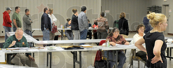 Waiting game: Voters wait patiently for their turn at the polling place at the Sullivan County Fairgrounds Tuesday afternoon. The building  served Hamilton precincts #6 #5, and #1 of Sullivan County.