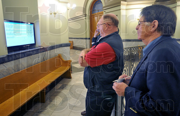 Close start: Clyde Kersey, right. watches early returns with Tom Hays in the Vigo County courthouse.