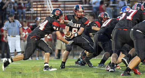 Hand-off: South Fullback #34, Logan Buske takes a hand-off from Danny Etling during game action Friday evening.