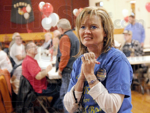 Happy: Tammy Pearson smiles as she realizes she's way ahead of her opponent in ther race for school board Tuesday evening.