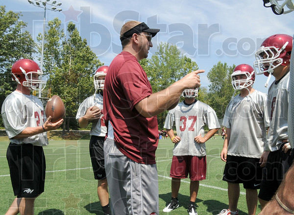 Rose: Jayson Martin works with his players during a recent football practice.