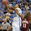 Whacked: Indiana State's #20, Dwayne Latham gets whacked across the arm as he goes up for a shot against Rose-Hulman's #31, Julian Strickland Tuesday night at Hulman Center.
