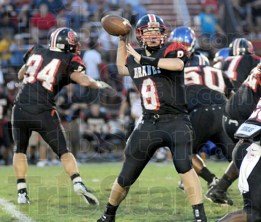 Lookin': Terre Haute South quarterback Danny Etling looks for an open receiver during Friday's game with Martinsville.