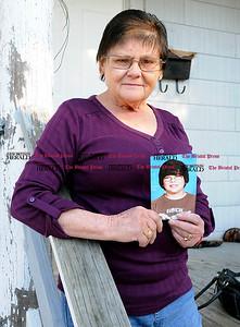 11/3/2010 Mike Orazzi | Staff Arlene Waye holds a photo of her grandson Henry Waye Jr.