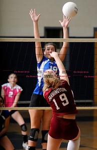 11/4/2010 Mike Orazzi | Staff Bristol Eastern's Mallory Kloss (19) and Farmington's Monika Krzak (19) during the CCC volleyball tournament at Bristol Eastern High School.
