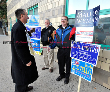 11/2/2010 Mike Orazzi | Staff Ed Krawiecki Jr. talks with Jeff Merrow and Bill Wolfe outside Chippens Hill Middle School on Tuesday evening.