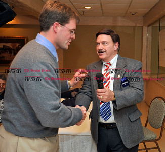 11/2/2010 Mike Orazzi | Staff Jason Welch (left) is congratulated by Sen. Tom Colapietro at Nuchie's after Welch defeated the incumbent.