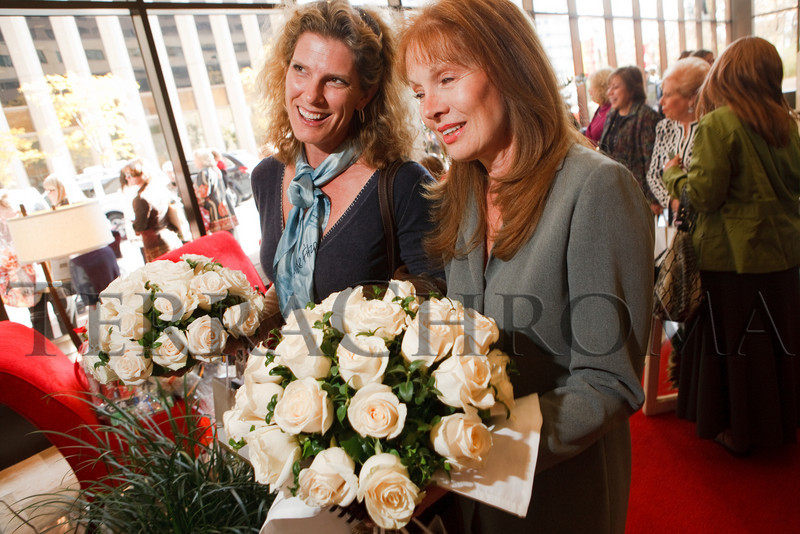 (Denver, Colorado, Nov. 10, 2010)<br /> Stacy Wiegers and Pamela Fraser leave the luncheon with table centerpieces bought to support The Guild.  The 2010 Brass Ring Luncheon and Fashion Show, hosted by the The Guild of The Children's Diabetes Foundation at Denver, at the Denver Marriott City Center in Denver, Colorado, on Wednesday, Nov. 10, 2010.<br /> STEVE PETERSON