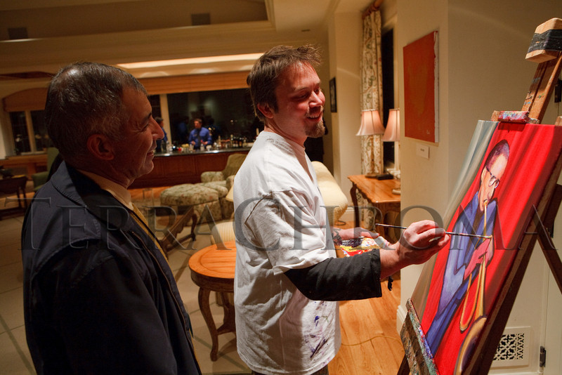 "(Cherry Hills Village, Colorado, Nov. 16, 2010)<br /> Artists Mario Acevedo and Eric Matelski (painting ""Ron Miles"") are both donating to the Dine & D'art event.  ArtReach Dine & D'art Kick-Off Party at the Schneider home in Cherry Hills Village, Colorado, on Tuesday, Nov. 16, 2010.<br /> STEVE PETERSON"