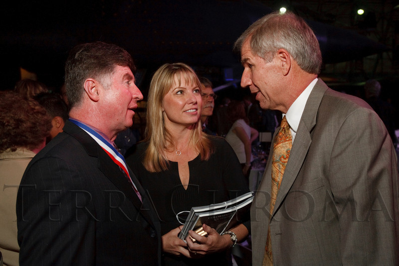 """(Denver, Colorado, Nov. 20, 2010)<br /> Astronaut Tom Henricks and his wife, Rebecca, speak with Greg Anderson (WOTR CEO).  The 2010 """"Spreading Wings Gala,"""" benefiting Wings Over the Rockies and the Spreading Wings youth education programs, at the Wings Over the Rockies Air & Space Museum in Denver, Colorado, on Saturday, Nov. 20, 2010.<br /> STEVE PETERSON"""