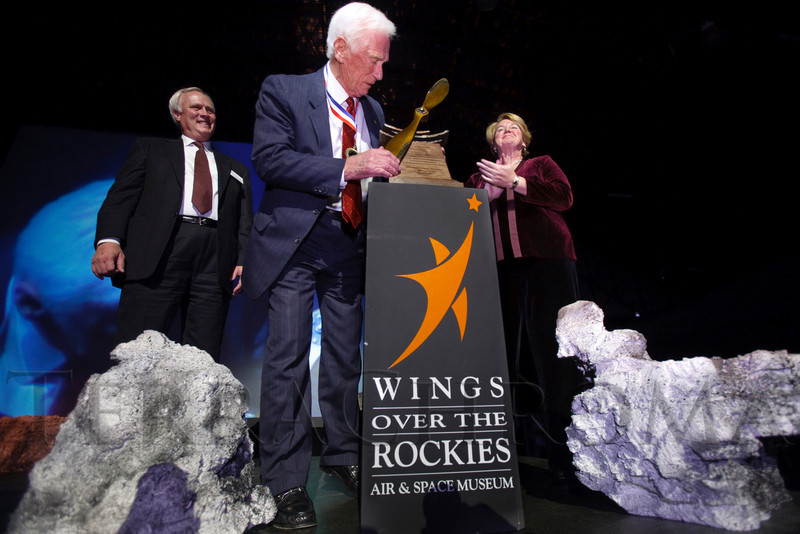 "(Denver, Colorado, Nov. 20, 2010)<br /> Gene Cernan gets a close look at his Spreading Wings Award, with Harold Smethills and Joanne Maguire congratulating him during a standing ovation.  The 2010 ""Spreading Wings Gala,"" benefiting Wings Over the Rockies and the Spreading Wings youth education programs, at the Wings Over the Rockies Air & Space Museum in Denver, Colorado, on Saturday, Nov. 20, 2010.<br /> STEVE PETERSON"