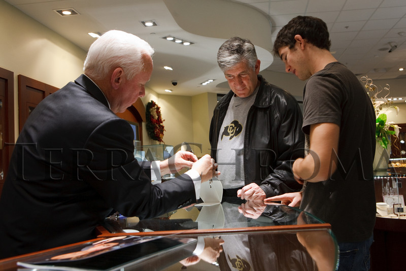 (Centennial, Colorado, Nov. 27, 2010)<br /> Ralph Klomp helps David Brody and Jason Brody (son) with some shopping.  Grand opening of Trice Jewelers at The Streets at SouthGlenn in Centennial, Colorado, on Saturday, Nov. 27, 2010.<br /> STEVE PETERSON