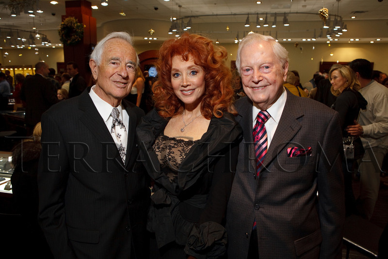 (Centennial, Colorado, Nov. 27, 2010)<br /> Marvin and Judi Wolf with Donald Seawell.  Grand opening of Trice Jewelers at The Streets at SouthGlenn in Centennial, Colorado, on Saturday, Nov. 27, 2010.<br /> STEVE PETERSON