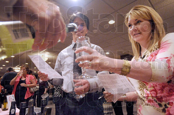 "Tasting 1-2-3: Tim And Amy Prestridge taste a wine offering at the ""A Taste, A Toast, A cure"" event at the Ohio Building Thursday evening."