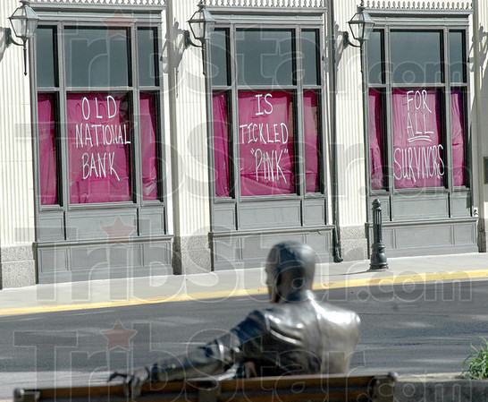 Max tickled pink: The Old National bank at 7th and Wabash shows its support for the Race For The Cure.
