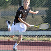 Service: South's number one singles player Cameron Crawford serves during early match action against North's Nate Sanders.