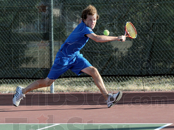Chase: North's Nate Sanders chases the ball during match action against Cameron Crawford of South.