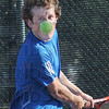 Nose for the game: North's number one singles player Nate Sanders keeps his concentration as he watches an incoming ball during match action with Cameron Crawford of South.