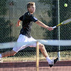 Got it: South's Cameron Crawford gets to reaching backhand during match action against Nate Sanders of North.