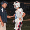 Tribune-Star/Joseph C. Garza<br /> The next play is...: Terre Haute North coach Chris Barrett and quarterback Chad Holler confer on the sideline at Memorial Stadium during the North-South football game Friday, Aug. 27.