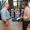 Tribune-Star/Joseph C. Garza<br /> Recycling at work: Walmart Zone Manager Ed Gillie talks with Marilyn Bahney of the Rural Community Academy in Graysville about the company's recycled shopping bags at the West Central Indiana Recycling Summit Thursday at Rose-Hulman.