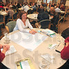 Tribune-Star/Joseph C. Garza<br /> Community recycling: Goodwill Industries of the Wabash Valley's Marlene Cox and Meredith Osburn discuss with Jay Etling of the Vigo County School Corporation the ways that the organizations can work together to recycle during the West Central Indiana Recycling Summit Thursday at Rose-Hulman.
