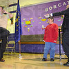 Warming up: Rio Grande Elementary School 4th grade teacher Jason Childress  gives and example of his disco moves he put on display later in the evening at the school dance. The event was a fundraiser for Riley Childrens' hospital. Watching are Trenton Williams, Riley Champion for 2010 and Riley Foundation Vice-president Greg Williamson.