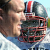 Big man: South's Zack Lewis listens to coach Raetz at the start of Thursday's practice session.