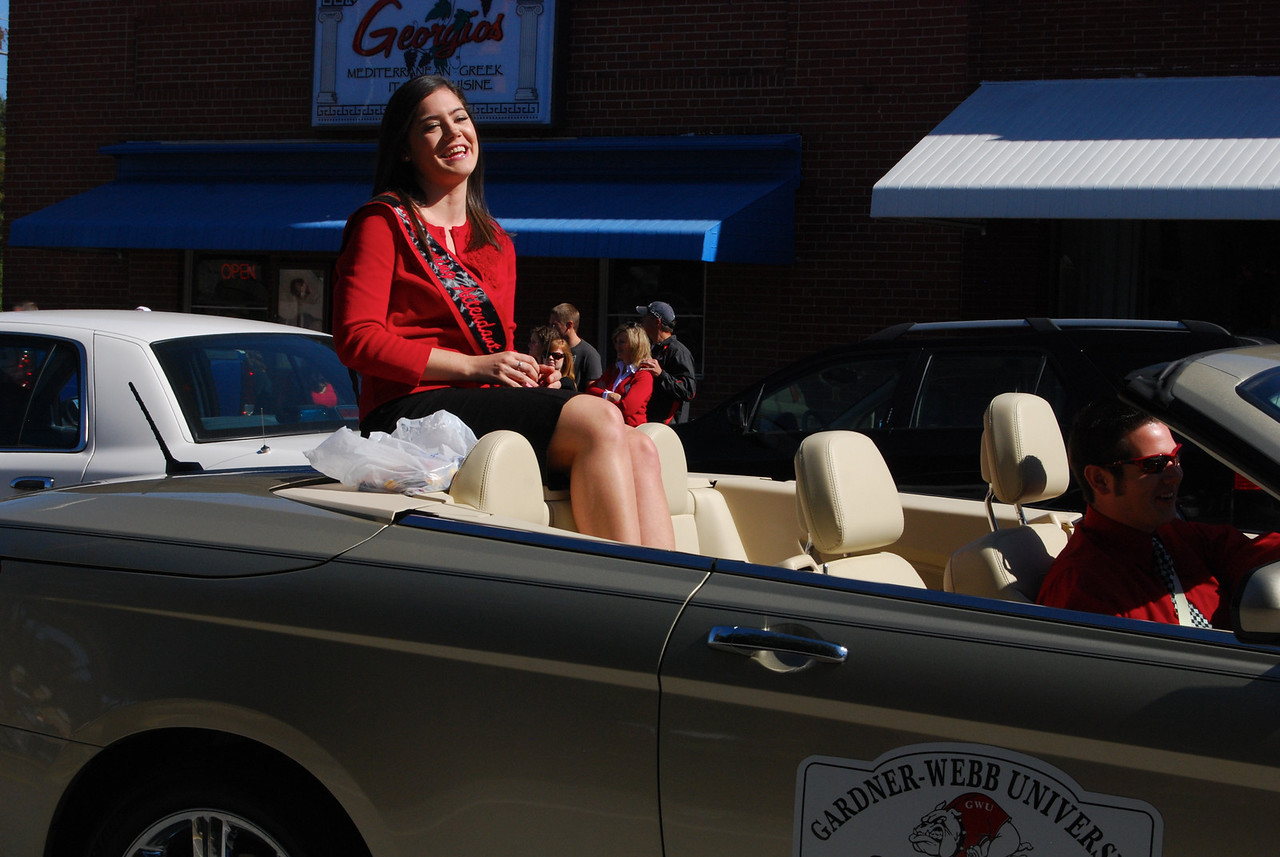 Students, cheerlearders, and the marching band made their way down Main Street for the annual homecoming parade. Senior Stephanie Gibbs was crowned Homecoming Queen at halftime. Photo by Haley Doolittle