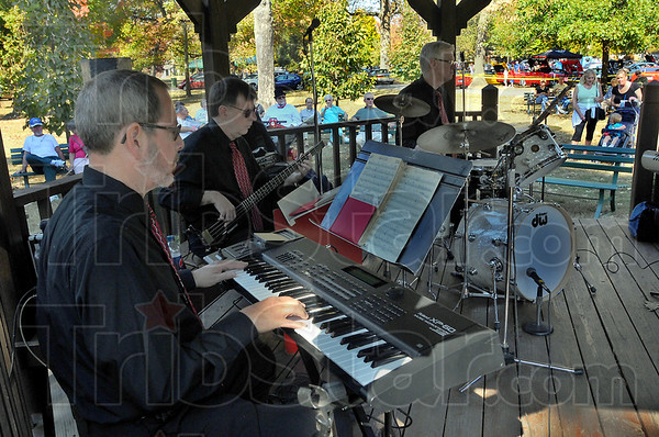 In concert: The Men of Note were one of the music attractions at Old Fashioned Days and Art Too at Collett Park Sunday afternoon. HereDavid Gibbs on keyboard Mark Ford on bass and drummer Jim Thistle play for the gathered crowd.