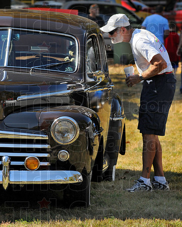Looking in: John Trevarthan looks over the interior of a 1948 Ford Super DeLuxe at the Old Fashioned Days and Art Too at Collett Park Sunday afternoon.