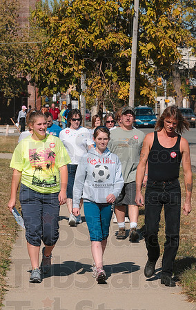 Tribune-Star/Joseph C. Garza<br /> Stomping out hunger with each step: Vigo County Crop Hunger Walk participants Miranda Camp, Carly Ring and Mark Hutson walk in Sunday's walk along Eighth Street.