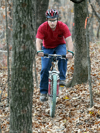 "Mountain biker: Josh Pickering rides the ""orange trail"" near Mill Dam in Clarksville, Ill. Sunday afternoon. Pickering spent several months carving the trail out of the wilderness."